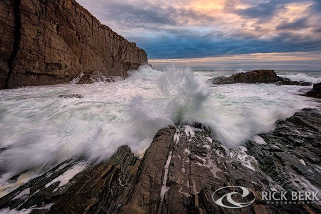 A wave breaks over the rocks at Bald Head Cliff, in Cape Neddick, Maine.